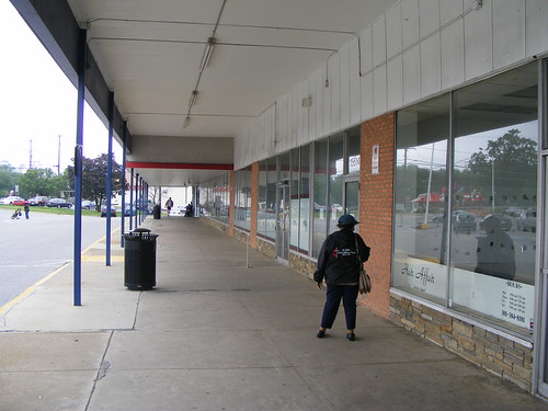 Woman In The Empty Shopping Center