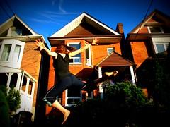 Seventy - Four ................ 365 (jillandrowan) Tags: summer house selfportrait toronto brick home jump vines olympus 365 picnik hangingbaskets 74365