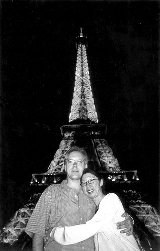 P & E and the Eiffel tower at night black & white