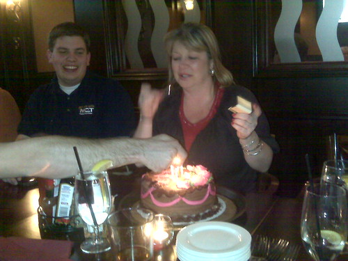 Sharon Looking Suprised as Stan Lights Candles