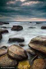 Bungan Beach (-yury-) Tags: ocean longexposure morning sea sky beach rock stone clouds sunrise sydney wave australia nsw bungan supershot    abigfave anawesomeshot ultimateshot