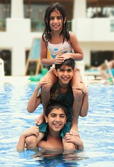 The Triple Trouble (front page explored ) (Ghadeer Q) Tags: summer portrait sun holiday water pool smile kids swimming canon easter fun three redsea daughter egypt sharmelsheikh explore mai laugh