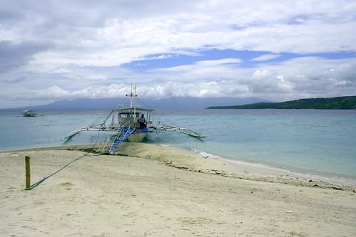 boat docked at shifting sand bar