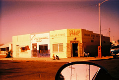 Main Street #16: Dollar Store (kevin dooley) Tags: auto road street camera city arizona playing southwest film window phoenix car st by kids analog corner 35mm hair children lens outside drive store lomo lomography automobile fuji shot desert market cam main touch central az professional plastic velvia dollar fujifilm salon 100 johns convenience phx 100f trashcam suntone drivebt