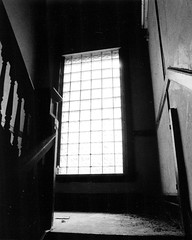 Braddock, PA (capwell) Tags: windows light blackandwhite abandoned film glass stairs pennsylvania exploring pa staircase apartmentbuilding ue braddock braddockpa