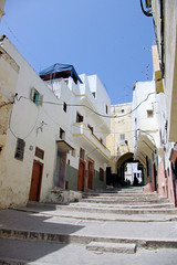 Up to the Kasbah (cwgoodroe) Tags: ocean africa street old city sea summer people sun fish bus colors metal ferry plane children cafe sand ancient colorful doors artistic pentax vibrant muslim poor streetlife mosque arabic panasonic doorway morocco arab friendly moors conservative script casbah vegtable merchants continent merchant christians tangier monger moroccan tanger kasbah cleric sadfaces metaldoors fishmerchant casba casbha dailylifeportrait
