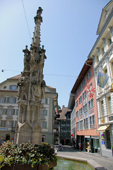 Lucern Fountian (cwgoodroe) Tags: sun mountain lake snow alps green church statue ferry fairytale swimming switzerland boat europe locals suisse swiss sunny location farms movieset luce swissalps lucern medivil beerpasture
