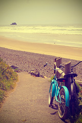 bikes (Michelle Elaine.) Tags: ocean carnival blue cute beach bicycle photoshop canon vintage landscape geotagged fun outside spring sand whimsy soft pacific action path joy dream bikes naturallight retro processing imagination dreamy oregoncoast westcoast vignette whimsical archcape sliders hss hugpoint bluebike cs5 canon40d hugpointstatepark