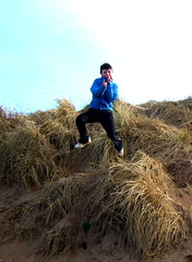 The Karate Kid in flight (moymackay) Tags: birthday winter snow beach boys jumping sand fife dunes east saul gullane lothian sledging eirinn hendos williamhope
