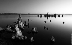 a B&W morning (kh-photos ~ Kurt ~) Tags: ca morning bw usa lake beach water sunrise dawn mirror rocks alien towers smooth earlymorning rocky gradient rough monolake tufa silky coarse canon1022mm alienplanet 40d explore25feb2009