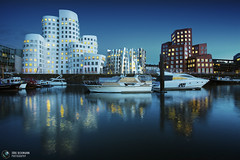 Blue Harbour (Jrg Dickmann) Tags: blue topf25 architecture buildings germany geotagged deutschland harbor topf50 harbour dusk wideangle gehry architektur canon5d bluehour dusseldorf hafen dsseldorf rhine rhein frankgehry duesseldorf nightfall neuerzollhof medienhafen 17mm zollhof canon1740 mediaharbour mediaharbor jrgdickmann geo:lat=51217133 geo:lon=6757295