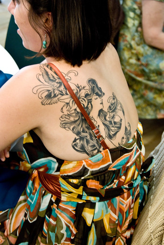Random Wedding Guest With Lovely Mucha Tattoo