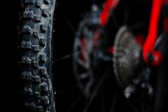 MTB tyre on black (Jase_MK) Tags: mountain black bike bicycle dof bokeh depthoffield mtb tyre fsr specialized kenda strobist