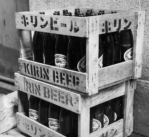 KIRIN BEER EMPTIES IN ALLEY by roberthuffstutter