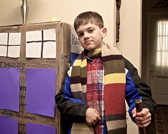 (heatherbirdtx) Tags: family blue boy portrait home scarf walking kid child post serious box furniture coat flash young cardboard homemade gravity doctor doctorwho stick gravitas policecallbox demeanor