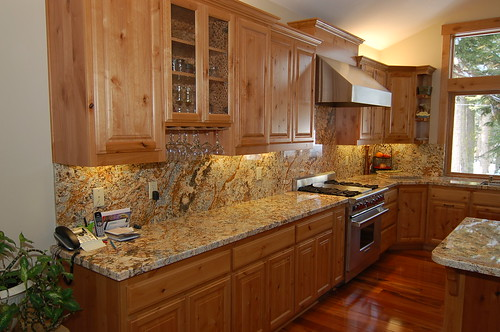great-looking kitchen with knotty alder cabinetry complemented