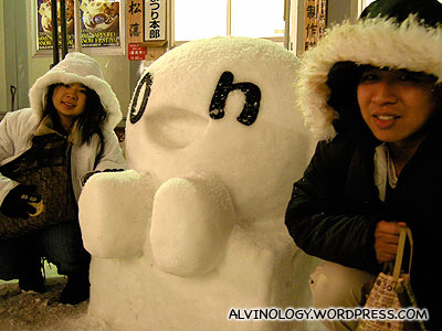 Meiyen and Mark, posing with a cute looking tiny snow sculpture