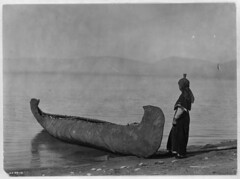 Native American Edward Curtis Kutenai Woman on the Shore with Canoe (griffinlb) Tags: west photography photo native indian nation first tribal edward american pre sheriff tribe ethnic curtis indigenous columbian amerindian amerind amerigine