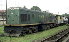 Philippine National Railways (PNR) Diesel locomotive 904 on an up goods train (northbound) in a crossing loop at San Pablo, Laguna, Philippines.