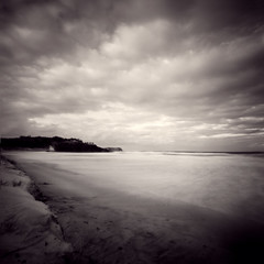 dreamtime beach (sue.h) Tags: ocean sky 6x6 film beach water clouds mediumformat island sand waves head australia pinhole 120film newsouthwales zero2000 zeroimage headland dreamtime fingal fujicolorpro160c convertedtogreyscaleandsplittonedinphotoshop