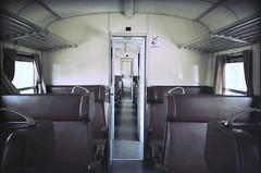 ferrovie del sud est, dentro il vagone (Tatinax) Tags: xpro stazione puglia taranto binari martinafranca treni pellicola ferroviedelsudest