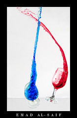Dancing Colors (Emad AL-Saif) Tags: blue red color water glass colors canon drops kuwait splash mixture q8 aplusphoto colourartaward alsaif