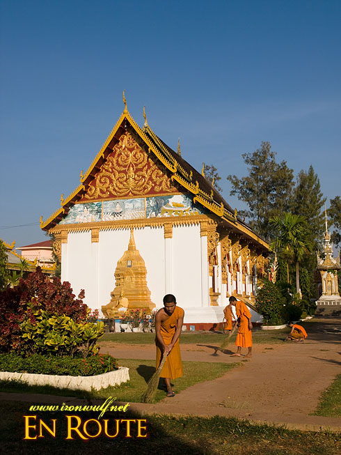 Laos Wat Luang Sweeping Monks