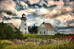 Panmure Island Lighthouse, PEI (sminky_pinky100 (In and Out)) Tags: trees red sky cliff lighthouse white canada green texture clouds fence pei personalbest 5photosaday atlanticprovinces bej mywinners omot ruralexcellence citrit eyejewel betterthangood theperfectphotographer panmureislandlighthouse artistictreasurechest visionquality