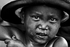 Tondo, Manila - Give him a kiss please (Mio Cade) Tags: poverty boy portrait bw baby white black love photography kid community toddler kiss child philippines poor dirty kind manila scavenger humanint