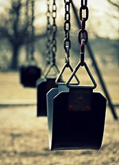 Empty Swings (TLW Photography) Tags: world life people motion green art love up set dead photography hope photo big nikon focus perfect photographer dof close image photos good live tripod swings group award images move swing we fave burn simplicity than need lonely but alive quite dslr simple discovery better depth partner emptiness movements finest tlw masterpiece the in tomasz wasik a mywinners abigfave nikond40x d40x