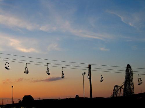 chair lift and phantom's revenge at sunset