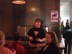 Tex pours some Port Townsend beers during a Seattle Beer Week tasting with the shiny new taps in the background.