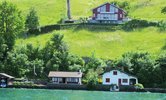 Lakefront Homes (cwgoodroe) Tags: sun mountain lake snow alps green church statue ferry fairytale swimming switzerland boat europe locals suisse swiss sunny location farms movieset luce swissalps lucern medivil beerpasture
