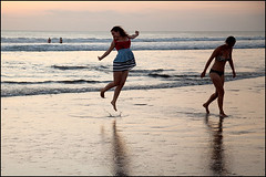 girls on Kuta beach - Bali (Maciej Dakowicz) Tags: sunset sea sky bali woman tourism beach girl indonesia jump asia tourist moment kuta kutabeach souheasasia