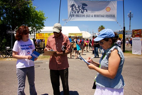 Lynda, a veteran community organizer helps JazzFest goers sign up to say 'I'm In'