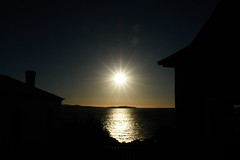 Sunset in Tasmania (Alex E. Proimos) Tags: light sunset shadow sun house reflection love beauty sunrise dark star ray glow shadows view magic rays magical darkened proimos alexproimos