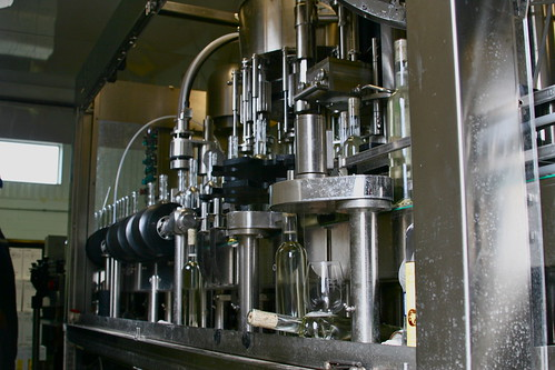 The bottling and corking machine in action