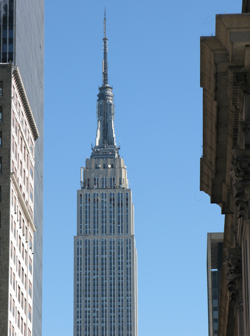 the Empire State Building as seen through other buildings and the main post office, Manhattan, NYC