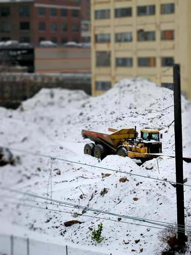 Toy truck in snow by you.