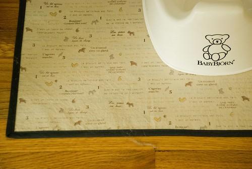 finn's room :: iron-on vinyl fabric mat to protect floor under baby potty