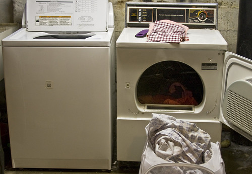 A clothes washer and clothes washer with laundry done.