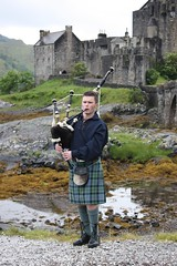 Young Piper at Eilean Donan Castle (flambard) Tags: music castle highlands kilt highland instrument piper bagpipes eileandonan tartan lochduich eileandonancastle
