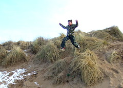 Saul mid flight (moymackay) Tags: birthday winter snow beach boys jumping sand fife dunes east saul gullane lothian sledging eirinn hendos williamhope