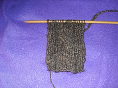 spun sheep wool being knit into scarf