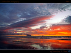 Of Innocence and Glory (tomraven) Tags: ocean sunset sea newzealand sky sun beach clouds reflections geotagged interestingness surf framed explore frontpage 2009 kapitiisland explored otakibeach inexplore theperfectphotographer damniwishidetakenthat cffaa tomraven geo:lat=4074433 geo:lon=175110397 q209