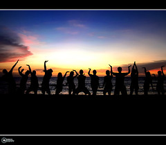 a pose for twilight | explore (rev_adan) Tags: blue light sunset shadow red sea sky people orange beach silhouette yellow clouds canon project pose fun dance interestingness twilight philippines silhouettes ixus explore shore egyptian actress actor frontpage mindanao initao flickrsbest revadan