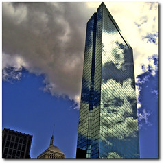 The clouds reflection over Hancock! (RajRem) Tags: city travel blue cambridge abstract reflection building tower glass boston skyline architecture clouds skyscraper canon square ma photography cityscape view image top massachusetts architectural highrise reflective reach architects johnhancock copley prudential backbay zooming bostonist metroboston rajrem