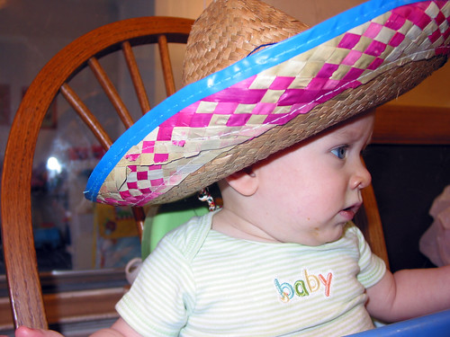 A big hat on a baby.