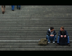 Stairs (It's Stefan) Tags: cold men travelling lines linhas stairs composition walking grey waiting sitting geometry streetlife guys backpack talking suitcase gomtrie twopeople lignes  comunicacin geometria hablar lneas linien  hablando comunicar      stefanhoechst