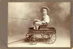 Boy in wagon (Mirror Image Gallery) Tags: toywagon antiquewagon victoriantoys antiquetooy